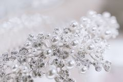 Jewel with pearls and diamonds on a white background.  Stock Images