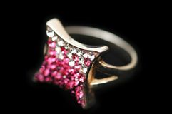 Jewel ring with white and pink. Stones  isolated on black Stock Image