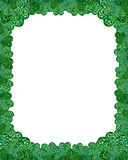 Jewel shamrock border frame. Photo of jewels inset into shamrock cookie cutter, arranged in various sizes, with a mosaic tile twist Royalty Free Stock Photo