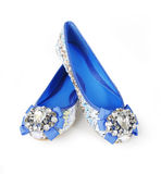 Jeweled blue flats shoes. Isolated on white Royalty Free Stock Images