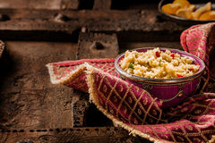 Jeweled Couscous in Ornate Dish on Wooded Table Stock Photography