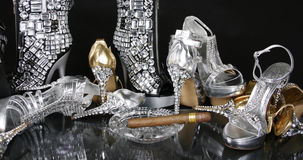 Jeweled Gold and Silver Shoes. Rhinestone Embellished Gold and Silver Pumps on a black background Royalty Free Stock Photo