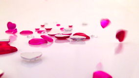 Jeweled Hearts Falling on White Background. Shiny jeweled red pink Valentine's Day hearts falling and bouncing on white background stock video footage