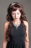 Jeweled leaves. Young lady posing with long curled hair and jeweled leaves Royalty Free Stock Images