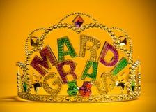 Jeweled Mardi Gras crown on a yellow background. A jeweled Mardi Gras crown on a yello backgroung Stock Photos