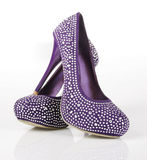 Jeweled Purple Shoes. On a white background Royalty Free Stock Photo