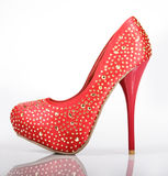 Jeweled Red Shoe. Jeweled red heel on a white background royalty free stock photography