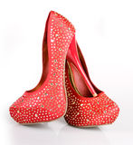 Jeweled Red Shoes. Jeweled red heels on a white background stock photo