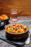 Jeweled Rosh Hashanal rice. On a wood background. the toning. selective focus Royalty Free Stock Photography