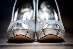 Jeweled silver wedding shoes. A close up of jeweled silver sparkly wedding shoes Royalty Free Stock Photos