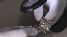 Jeweler in action stock video