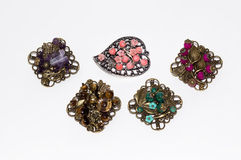Jeweler brooches of handwork. On a white background Royalty Free Stock Photo