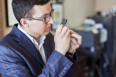 Jeweler examining diamond through loupe Stock Image