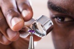 Free Jeweler Examining Diamond Through Loupe Stock Photography - 147807282