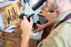 Jeweler Examining Ring