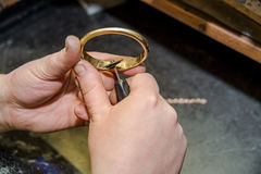 Jeweler hands at work Royalty Free Stock Photography