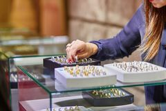Jeweler helping client to choose wedding ring Royalty Free Stock Photos