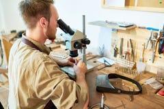 Jeweler Inspecting Stones royalty free stock photography