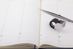 Jeweler magnifier and tweezers. On the diary, tools gemologist Stock Images