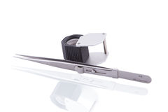 Jeweler magnifier and tweezers Royalty Free Stock Image