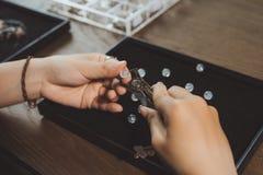 Jeweler making of handmade stone beads jewellery. Stock Images