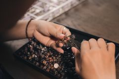 Jeweler making of handmade stone beads jewellery. Jeweler making of handmade stone beads jewellery Royalty Free Stock Image