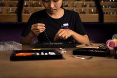 Jeweler making of handmade stone beads jewellery. Jeweler making of handmade stone beads jewellery Stock Images