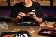 Jeweler making of handmade stone beads jewellery. Jeweler making of handmade stone beads jewellery Royalty Free Stock Photography