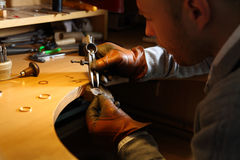 Jeweler measuring a ring with compass divider Royalty Free Stock Photography