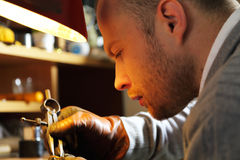Jeweler measuring a ring with compass divider Stock Photos