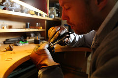 Jeweler measuring a ring with compass divider Stock Image