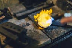 Jeweler melting gold Royalty Free Stock Photography