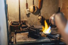 Jeweler melting gold Stock Images