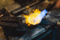 Jeweler melting gold. And making jewelry Stock Photography