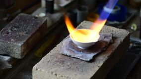 Jeweler melts gold in liquid state in crucible. Craft jewelery 4k resolution