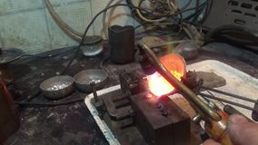 Jeweler melts metal. Weight, accessory accuracy stock video