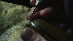 Jeweler paste diamond to golden wedding luxury ring. Craft jewelery