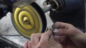 Jeweler polishing golden ring stock video