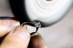 Jeweler polishing jewelry Royalty Free Stock Photo