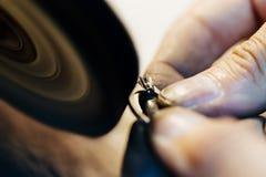 Jeweler polishing jewelry Stock Images