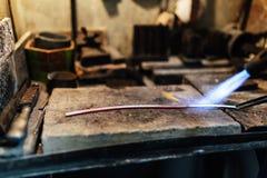 Jeweler processing metal bar Stock Image