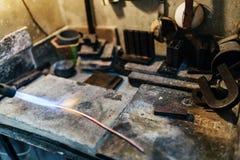 Jeweler processing metal bar Stock Photography