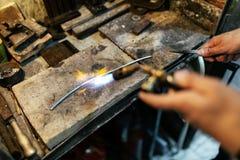 Jeweler processing metal bar Stock Images