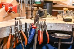 Jeweler`s workplace with a multitude of working tools stock image