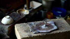 Jeweler turns raw wedding ring. Craft jewelry 4k footage