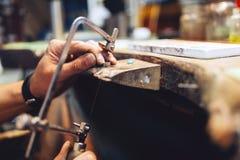 Jeweler using saw royalty free stock photo