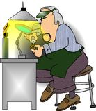 Jeweler at work. This illustration that I created depicts a man working on a gold ring Royalty Free Stock Photos