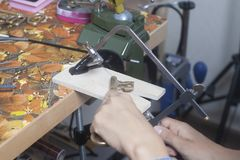 Jeweler working with jewerly saw. Jeweler working with jewerly saw close up stock photography