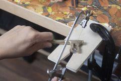 Jeweler working with jewerly saw. Close up royalty free stock photo
