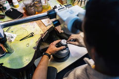 Jeweler working with optical device Stock Image